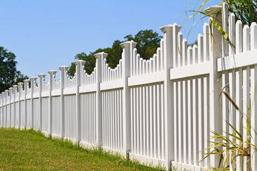 Image of standard fencing across a residential lawn
