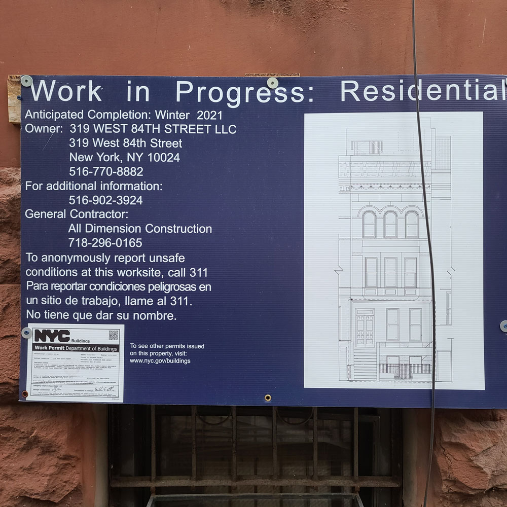 Work in Progress sign with building permit