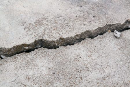 cracked concrete cement sidewalk foundation