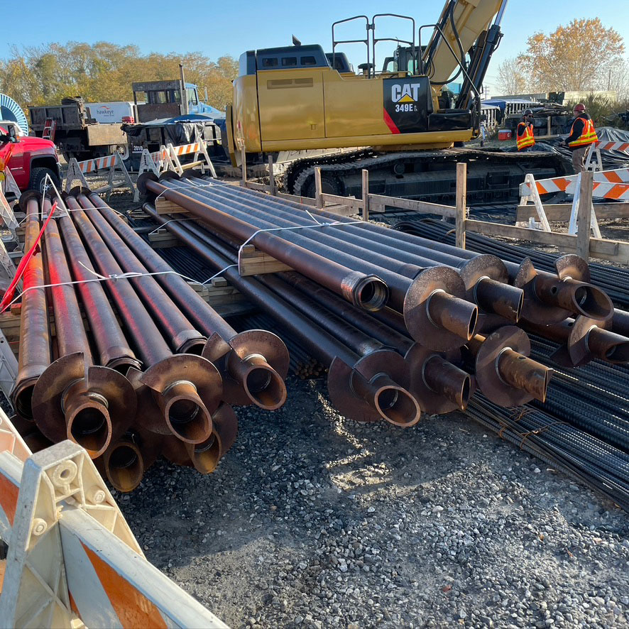 helical piles on site waiting for install